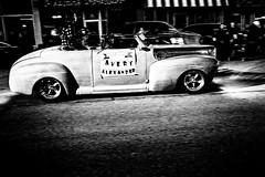 XPR20007 (alhawley) Tags: abstract american americanabstract americana arebureboke blackandwhite blur bw candid car everytownusa fujinonxf23mmf2rwr grain gritty highcontrast impressionistic monochrome mundane nightphotography photojournalism shadow usa parade hotrod street streetphotography provoke