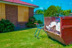 Parked (Erich Schieber) Tags: australia shoppingtrolley house architecture suburbia shoppingcart rubbishbin