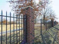 Fence in the Golfers (clarkcg photography) Tags: fence fencedfriday iron brick golfcourse brokenarrow sunny sunshine oak shadows light