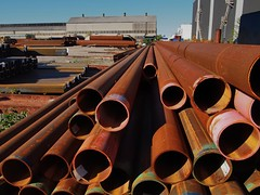 Rusted pipe, steel supplier's yard, South Etobicoke, Toronto (edk7) Tags: olympuspenliteepl5 edk7 2017 canada ontario toronto etobicoke southetobicoke newtoronto steelproductssuppliersyard industry industrial architecture building oldstructure rustedsteelpipe rust city cityscape urban works factory sky