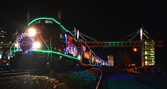 Out Beyond the Neon Lights (Jacob Narup) Tags: cp canadianpacific cpdavenportsub cpholidaytrain holiday holidaytrain canadianpacificholidaytrain cp2246 train trains railfan railroad railfanning christmas christmastrain neon light lights christmaslights davenport davenportiowa davenportia iowa gp20eco skybridge davenportskywalk skywalk davenportskybridge davenportriverfront bridge neonlights night nightexposure nighttime nightime