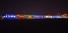 Neon Sky (Jacob Narup) Tags: cp canadianpacific cpdavenportsub cpholidaytrain holiday holidaytrain canadianpacificholidaytrain cp2246 train trains railfan railroad railfanning christmas christmastrain neon light lights christmaslights davenport davenportiowa davenportia iowa gp20eco neonlights night nightexposure nighttime nightime