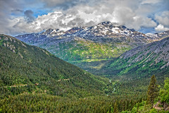 Alaskan Boundary Ranges (http://fineartamerica.com/profiles/robert-bales.ht) Tags: alaska forupload haybales landscape people photo places projects scenic canada sea coast travel sky rock coastline nature tourism north mountains mountain summer vacation scenery beach tourist outdoor landmark hiking pacific british bright bc famous clouds woods northern columbia paradise highway america cliff picturesque peak range forest britishcolumbia coastmountains pacificcoastranges robertbales whitepass train