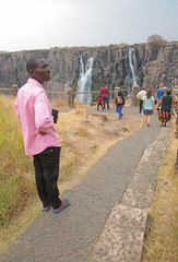 Pink Shirt Visitor (peterkelly) Tags: digital canon 6d africa intrepidtravel capetowntovicfalls victoriafalls zambia waterfall path trail man pink shirt cliff canyon gorge rocky rock