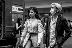 Tokyo 2019 (burnt dirt) Tags: shibuya tokyo japan asia japanese asian candid documentary street photography downtown metro urban city scramble crossing outdoor people person fujifilm xt3 fujinon 50mm f2 bw blackandwhite monotone monochrome woman girl smile laugh train station style fashion life real crowd tourist emotion expression portrait close nippon couple man stare mask