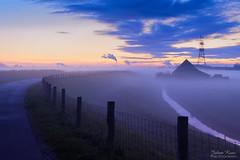 Blue Hour in the Polder (Johan Konz) Tags: bluehour polder purmer waterland netherlands landscape sunset blue sky dike farmhouse nikon d7500 water powerplant chimney fluegas watervapour road rural