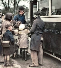 Getting them on (theirhistory) Tags: bus children war coat wellies boots
