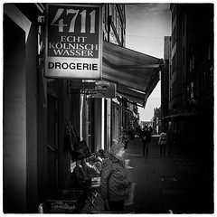 4711 - The fragrance of retirement :-) (Loek van Straaten) Tags: lübeck germany street streetphotography candid city people 4711 retirement pedestrianstreet woman lady shop drugstore blackandwhite black white bw monochrome loek vanstraaten
