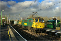 Buckby cans. (Jason 87030) Tags: longbucknby wcml green yellow longbuckby felixstowe traffordpark platform curve bend clouds sky weather uk rhym time jamsine northants northmaptonshire lighting frecht freight cargo december 2019 al6 class86 freightliner sony ilce alpha a6000 lens tag fast shot shoot