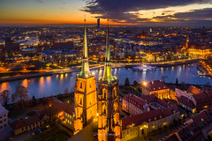 Wroclaw Towers (mitelski) Tags: aerial autumn church clouds evening illumination light outdoor river sky sunset water wrocław lowersilesianvoivodeship poland color image no people photography architecture famous place night building exterior illuminated travel destinations cityscape dusk city outdoors sunrise beautiful drone birds eye view fire