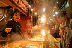 Nishiki's atmosphere (paul indigo) Tags: japan kyoto paulindigo atmosphere busy colour customers food lady market nishiki people portrait steam streetphotography style taste travel travelphotography warm
