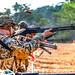 A U.S. Marine shoots the M1014 shotgun