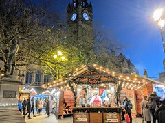 Stalls at Manchester Christmas Markets 2019 (Tony Worrall) Tags: welovethenorth nw northwest north update place location uk visit area attraction open stream tour photohour photooftheday pics country item greatbritain britain british gb capture buy stock sell sale outside dailyphoto outdoors caught photo shoot shot picture captured ilobsterit instragram england gmr manchester manc city night evening stalls bright xmas decorations illuminations festive christmas seasonal lights manchestertowerhall tower clock