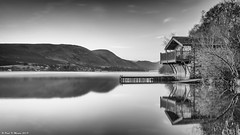 Duke of Portland Boathouse (Paul K Martin) Tags: cumbria lake district uillswater water reflection lakes boathouse rural mountains scenery scenic peaceful mono monochrome atmospheric pooley bridge jetty nikon d300s 18200mm f11 131 seconds lee filters cpl big stopper
