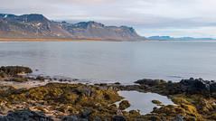 Rocks and mountains at Red beach at Búðir. (wooiwoo) Tags: redbeach iceland pool atlantic búðir mountains rocks snaefellsnespeninsula moss sea sand clouds budir