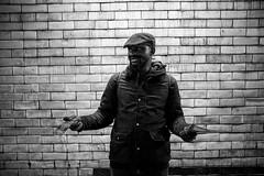 Pamphleting (Foto John) Tags: leica leicammonochrom246 leicammonochromtyp246 summiluxm35mmƒ14asphfle rangefinder streetphotography people man wall blackwhite blackandwhite blackandwhitethatsright monochrome london uk tracts