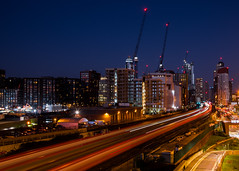 Trains in Vauxhall, London (traveller20) Tags: london vauxhall uk trains night lighttrails cranes