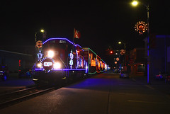 A Modern Polar Express (Jacob Narup) Tags: cp canadianpacific canadianpacificholidaytrain canadianpacificrailway cpholidaytrain holiday holidaytrain christmas christmastrain train trains railfan railroad railfanning cp2246 neon neonlights christmaslights holidaylights iowa cpmarquettesub gp20eco bellevue bellevueia bellevueiowa street streetlights streetrunning night nighttime nightime