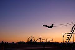 Free (BrianEden) Tags: california beach silhouette sunset pier losangeles musclebeach swings santamonica evening la