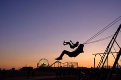 Swing at sunset (BrianEden) Tags: california beach silhouette sunset pier losangeles musclebeach swings santamonica evening la