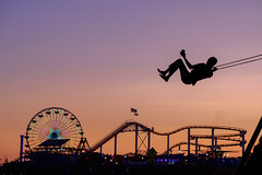 Above it all (BrianEden) Tags: california beach silhouette sunset pier losangeles musclebeach swings santamonica evening la
