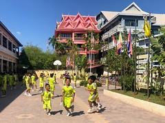 Schoolyard playtime, Siem Reap, Cambodia (mark brueckman) Tags: childhood schoolyard play yellow
