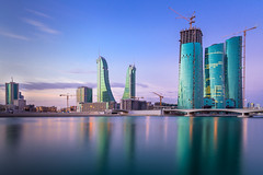 Bahrain Bay (jonasfj) Tags: nikon z7 mirrorless nikonz7 ftz ftzadapter 2018g 20mm primelens wideangle cityscape architecture construction building reflections water bahrainbay longexposure sky sunrise earlymorning bahrain manama middleeast development crane cranes busy clouds bridge city commercial