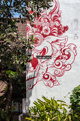 One side of the story (A Different Perspective) Tags: bali indonesia seminyak eye face red street streetart tooth vent wall white