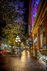 'By the light of a street lamp' - Historic Gastown (Christie : Colour & Light Collection) Tags: downtown gastown nightlights citylights vancouvercity historic vancouverbritishcolumbia nightlight artist painter palette originalsettlement earlysettlers canadianhistory vancouverhistory streetlamp streetview streetphotography nightphotography lowlightphotography lowlight lighting nightlighting downtownvancouver street waterstreet nationalhistoricsite turnofthecentury early1900s waterfront flickr nikon nikkor historicbuildings factory warehouses storefronts tree cobblestone sidewalk canada commercialbuildings vancouvereast window vancouverbc