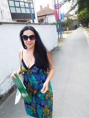 Nina ... on a mission... (sean and nina) Tags: summer hot sunglasses dark hair long dress heat nina brunette 2019 blue floral face neck hands warm pattern arms skin bare tan shoulders folder tanned street pink smile smiling walking outside outdoors candid croatia lips spaghetti straps croatian hrvatska serb petrinja woman girl beautiful beauty lady female happy girlfriend married gorgeous charm stunning wife charming fiancee cute necklace natural diamond jewellery