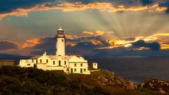 Lighthouse (joseph_donnelly) Tags: lighthouse light sky sun sunset clouds rays beams color luminar luminar4