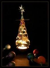 Christmas candle (kerwitcherwoo) Tags: christmas candle flicker light dark lightanddark candlelight motionblur baubles lowkey texture smileonsaturday