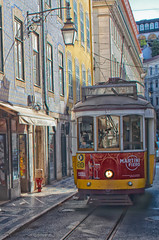 The Number 28 Tram, Lisbon, Portugal (Ray in Manila) Tags: shop historic europe touristy architecture buildings lamp 28 red yellow colourful cobbled street transport tram eos650d lisbon portugal