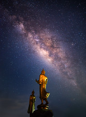 Beautiful milky way and Buddha statue at night (vithuncivil) Tags: abstract architecture art asia asian astronomy astrophotography background beautiful beauty black blue buddha buddhism buddhist color constellation cosmos culture dark galaxy gold golden graphic holiday landmark landscape light milky nature night outdoor religion sacred sculpture sky space star starry statue temple thailand tourism travel universe view wallpaper wat way worship