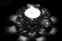 A Glimmer Of Hope (JULIANA LEFTEROVA) Tags: smileonsaturday lightanddark lightandshadows candle blackandwhite bw closeup reflections lowkey
