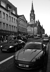 The name's Bond...James Bond (Valantis Antoniades) Tags: edinburgh scotland black white architecture cars vehicles aston martin jaguar street
