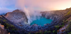 Panorama landscape view of Kawah Ijen at Sunrise. The most famous tourist attraction in Indonesia. (vithuncivil) Tags: ijen kawah indonesia crater landscape volcano lake sunrise view tourism java banyuwangi panorama asia sky scenic danger heat smoke adventure gas steam mist sulfur nature volcanic beautiful travel power rock mountain activity active exotic plateau east island people panoramic dirty ecology valley mineral exploration foggy eruption morning blue yellow water