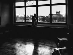 Tuesday (Luther Roseman Dease, II) Tags: monochrome silhouette window bw urban lowkey candid alone depth framing lines public blackandwhite noireetblanc narrative negroyblancofotografie shadows darkened contrejour