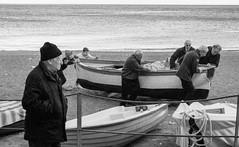 the silent watcher (lucafabbricesena) Tags: boat sailors italy oldmariner nikon d800 people beach tirreno sea twilight evening streetphotography oldman outside water bw blackandwhite streetshot street silent watcher costieraamalfitana