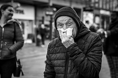 Winter Woes (Leanne Boulton) Tags: urban street candid portrait portraiture streetphotography candidstreetphotography candidportrait streetportrait eyecontact candideyecontact streetlife old elderly man male face eyes expression mood emotion feeling tissue cold winter weather virus nose sneeze tone texture detail depthoffield bokeh naturallight flu outdoor light shade city scene human life living humanity society culture lifestyle people canon canon5dmkiii 70mm ef2470mmf28liiusm black white blackwhite bw mono blackandwhite monochrome glasgow scotland uk