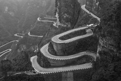 Road of Tianmen mountain national park, Hunan province, China (vithuncivil) Tags: mountain road tianmen china park hunan winding landscape nature zhangjiajie travel national tourism scenery green view tree curve high asia beauty background outdoor beautiful horizontal forest rock journey mist roads path map curvy stone province abstract danger summer sign nobody line environment mountains empty tropical