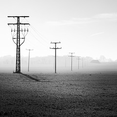 When the Sun Fights the Mist (Bernd Walz) Tags: landscape poles powerlines field mist fog sunlight rural countryside blackandwhite bnw bw monochrome fineart square minimalistic minimalism