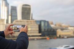 Tourist shot (Paul wrights reserved) Tags: tourist mobilephone mobilephotography london londonbuildings londonbridge framed city building buildings focus depthoffield dof apeture hand hands tech technology streetphotography