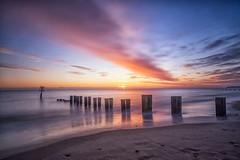 Gorleston Beach Sunrise (Geoffrey Tibbenham) Tags: coast beach seaside sunrise sunlight sky sea seascape sand groynes water winter openspace outdoors longexposure light colours fuji f28 zeiss lens touit xt1 gorleston norfolk eastanglia