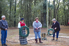 Harmony Hall Wreath Laying Ceremony. (dccradio) Tags: whiteoak nc northcarolina bladencounty harmonyhall harmonyhallplantation harmonyhallplantationvillage tree trees woods wooded forest ceremony wreathlaying people man woman lady christmasevent christmas winter december saturday weekend saturdayafternoon afternoon goodafternoon nikon d40 dslr