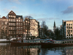Amsterdam (Angel Flores 2) Tags: amsterdam canal houses church river architecture urban explore city fujicags645 kodakektachrome400xepl boat canalcruise