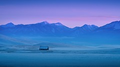Winter Barn Mountains Blue Hour 8322 A (jim.choate59) Tags: jchoate on1pics barn bluehour twilight mountains enterpriseoregon landscape lonely remote winter snow sunset desolate cold