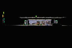 Lonely Highway (dangaken) Tags: gasstation servicestation garage midland midlandmi bp bpstation britishpetroleum m20 michigan night dark lights cars travel highway desolate latenight nightphotography gas fuel car truck neon expressstop
