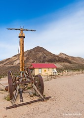 Folk art, Rhyolite (Photosuze) Tags: rhyolite ghosttown folk art nevada machinery desert mountains sky clouds buildings vintage