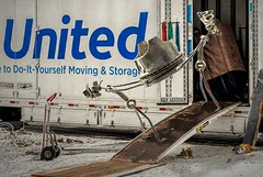 Moving Day (Wes Iversen) Tags: hss nikkor18300mm sliderssunday united composites humor moving movingvans painterly pushcarts ramps sculpture shoes snow trucks